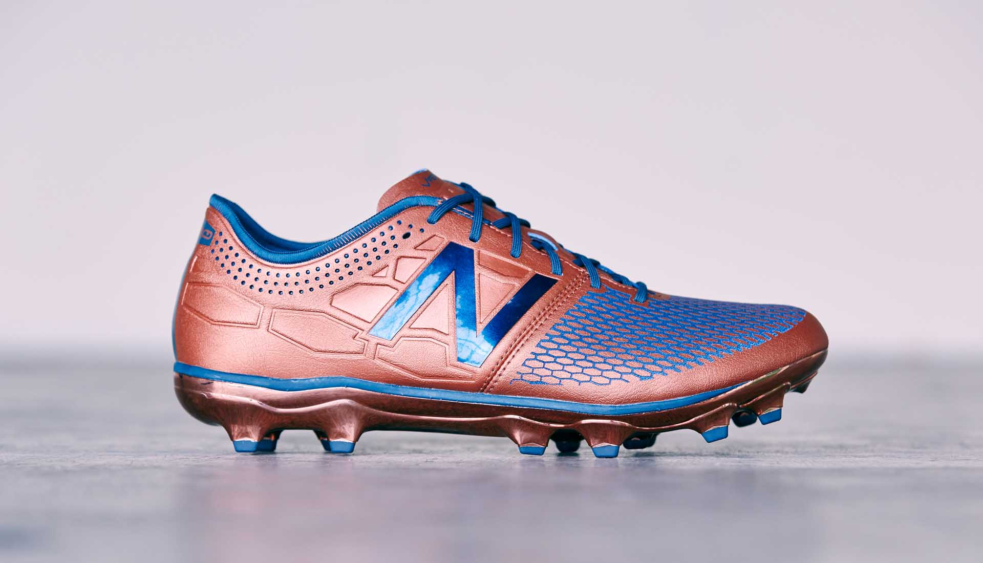 New Balance Visaro 2.0 Pro FG Conduction Pack - Cuivre/Bleu